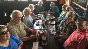 Photo of 10 people around a table.